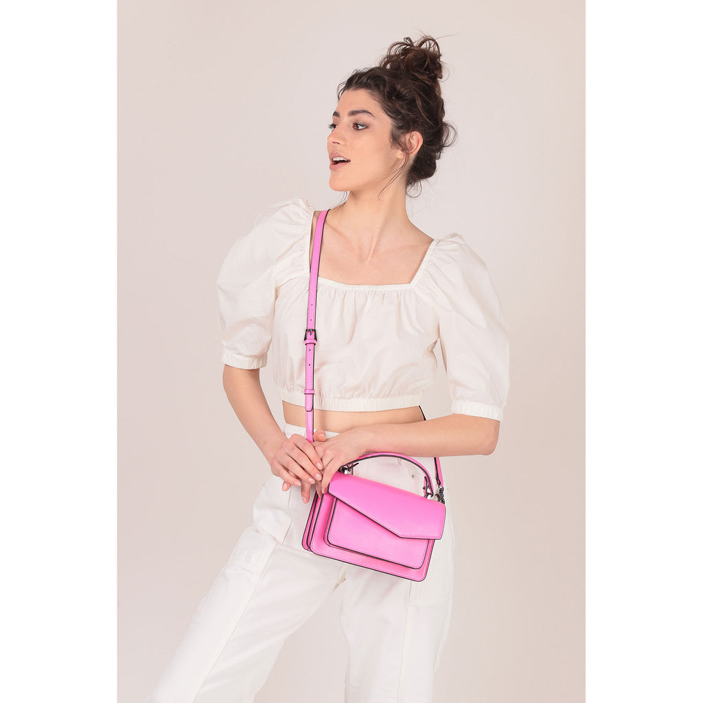 botkier cobble hill crossbody neon pink on figure