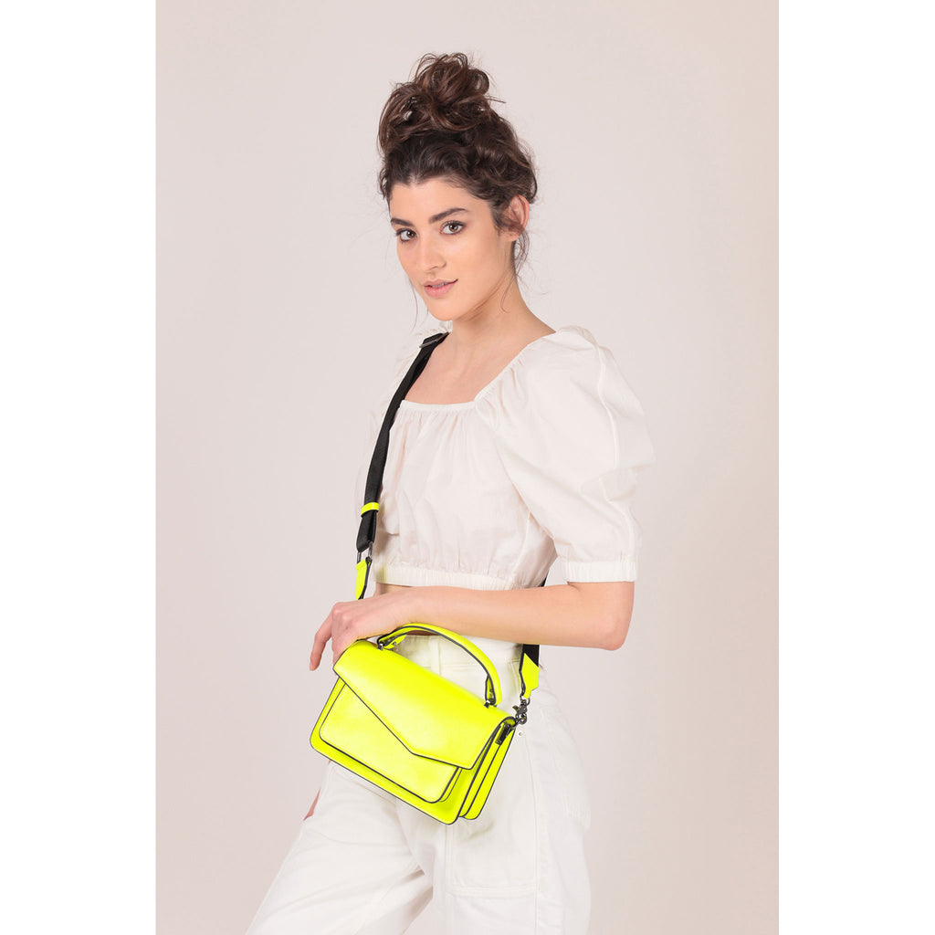 botkier cobble hill crossbody neon yellow on figure