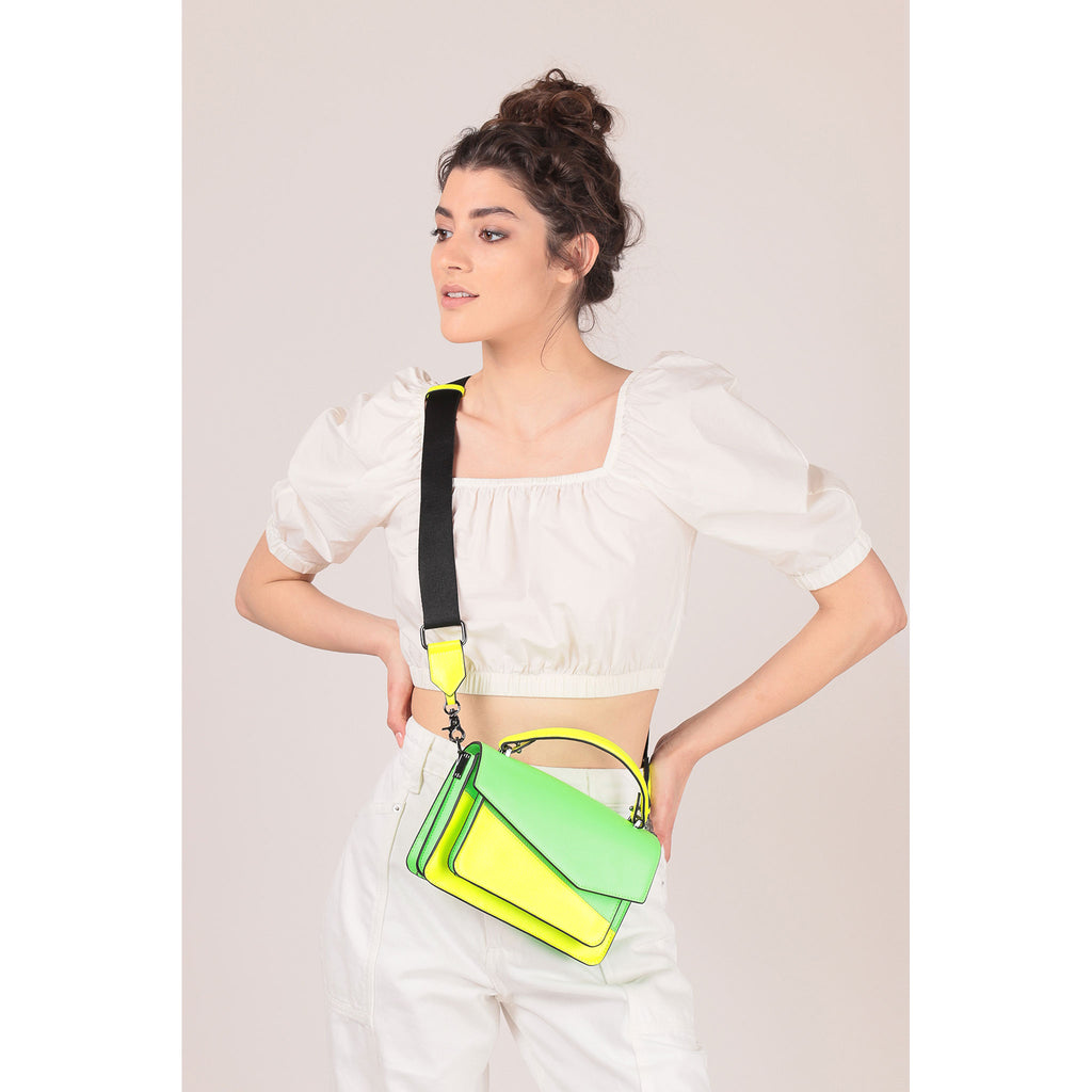 botkier cobble hill crossbody neon yellow sliced on figure crossbody
