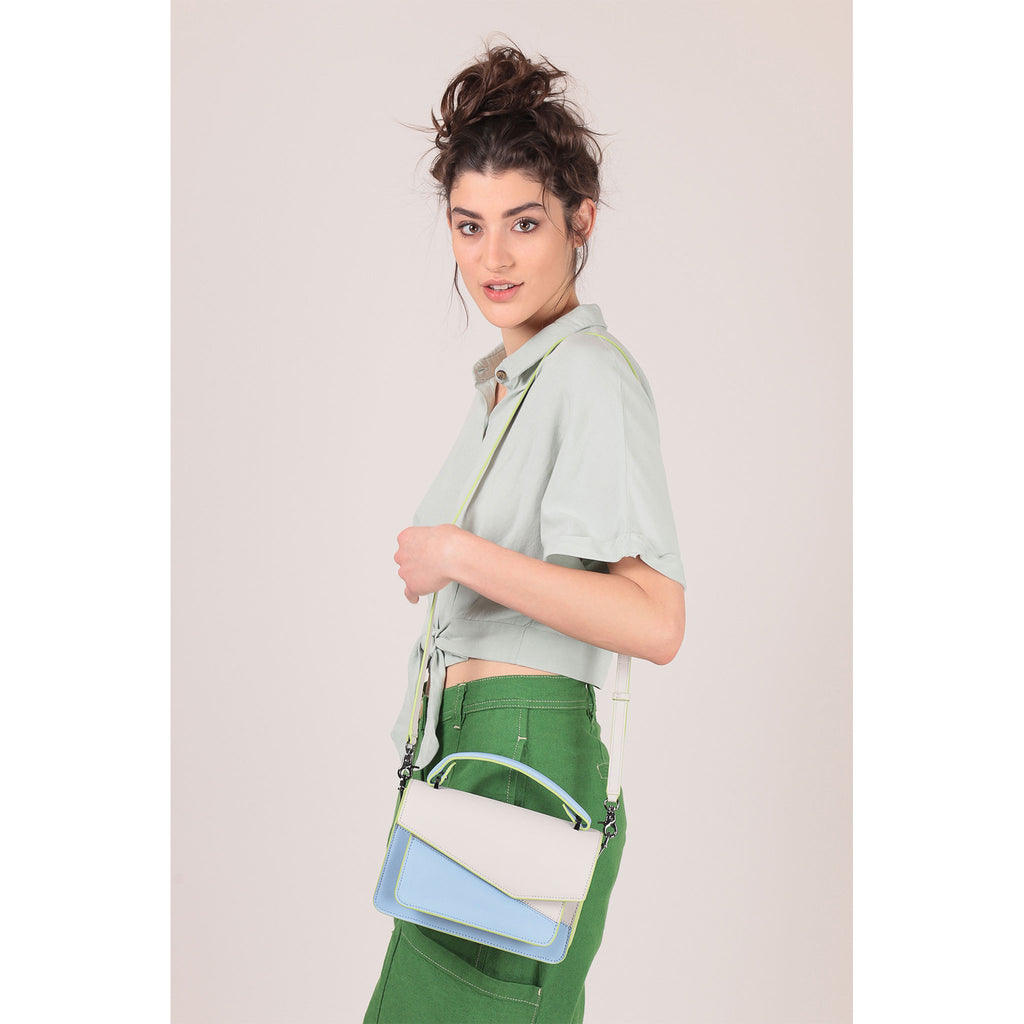 botkier cobble hill crossbody blue cadet sliced on figure crossbody