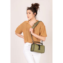 nomad crossbody moss on figure crossbody