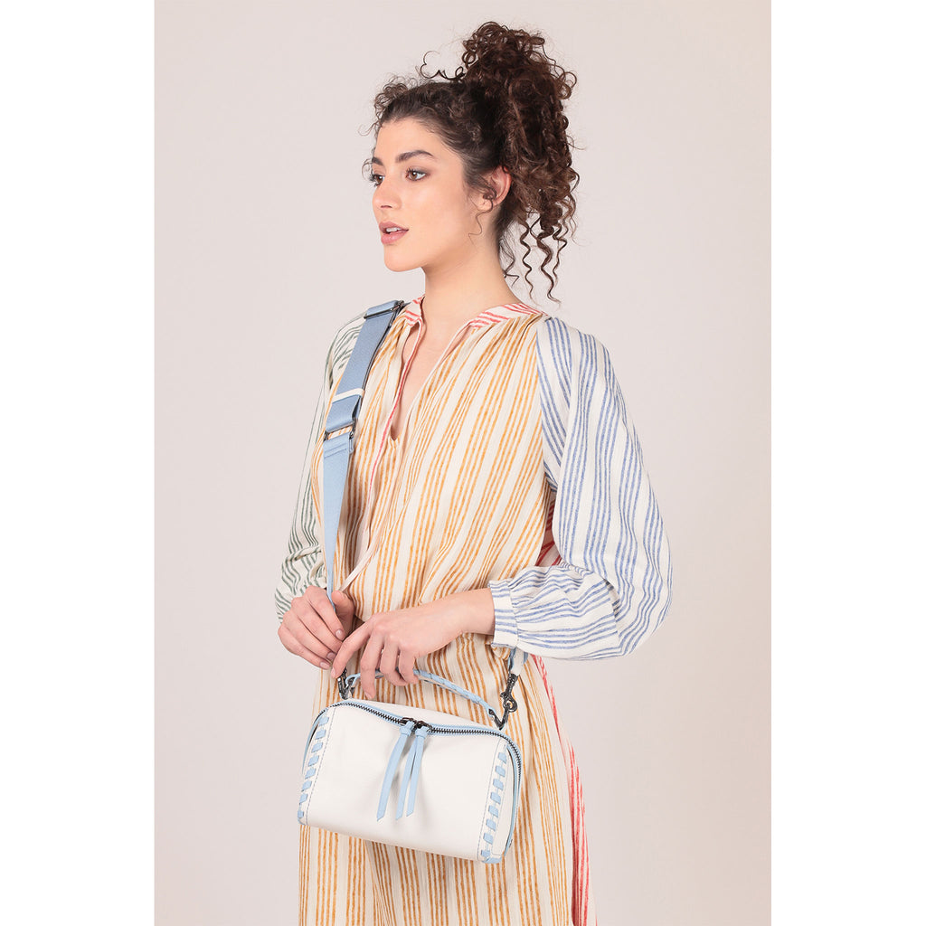nomad crossbody marshmallow on figure crossbody