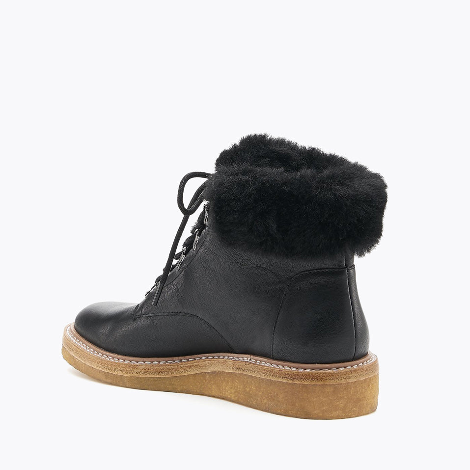 botkier winter boot black back angle