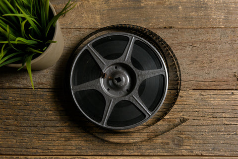 film reel on wooden background