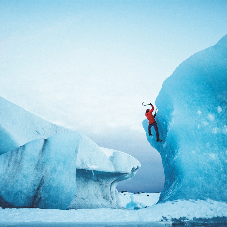 Ice Climber on a glacier wearing FutureLight.