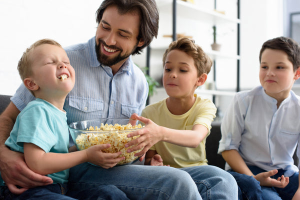 Family eating a bowl of popcorn.