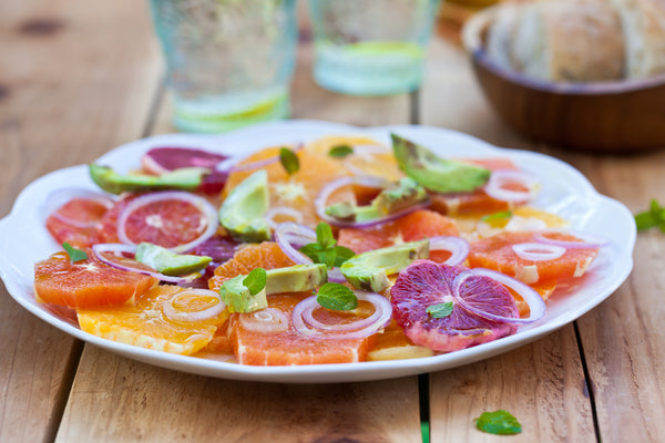 Blood orange and onion salad on a white plate