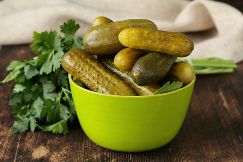 Pickles in a bowl serve as one of many healthy roadtrip snacks.