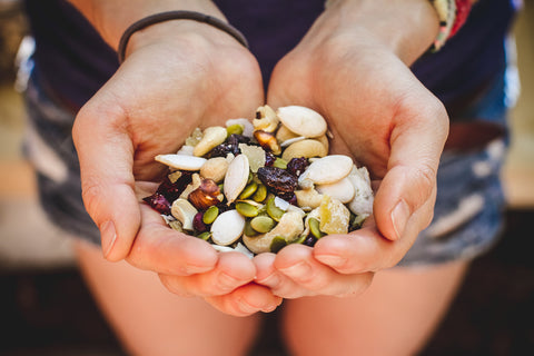 A hiker holds out a handful of homemade trail mix.