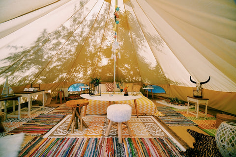 Tent with rugs and chairs