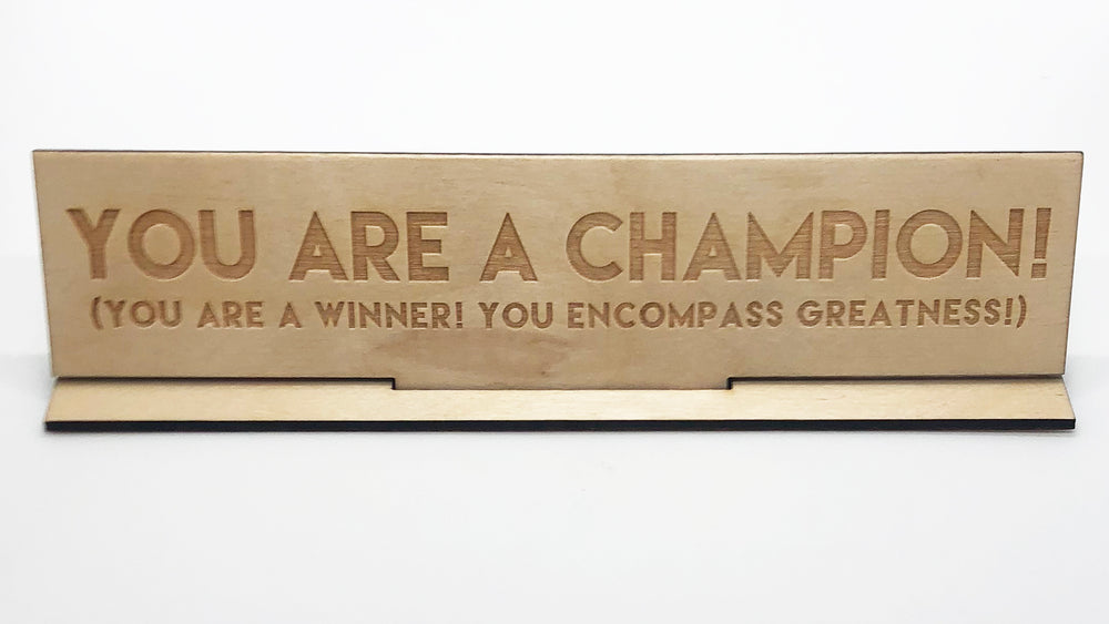 """You Are A Champion"" Wood Desk Plate"