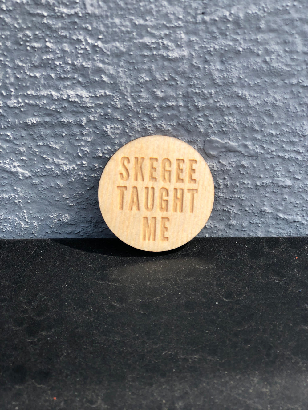 """Skegee Taught Me"" Wood Lapel Pin"