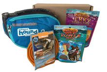 Dog gift box with dog backpack or hands-free leash, collapsible water bowl, and treats