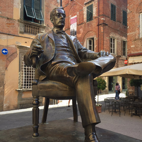 A Bronze Sculpture of Giaccomo Puccini Sits Before His Birthplace (LEO Design)