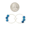 Handmade In Conifer Jewelry - Caribbean Blue Agate Silver Hoops Earrings Size next to coin