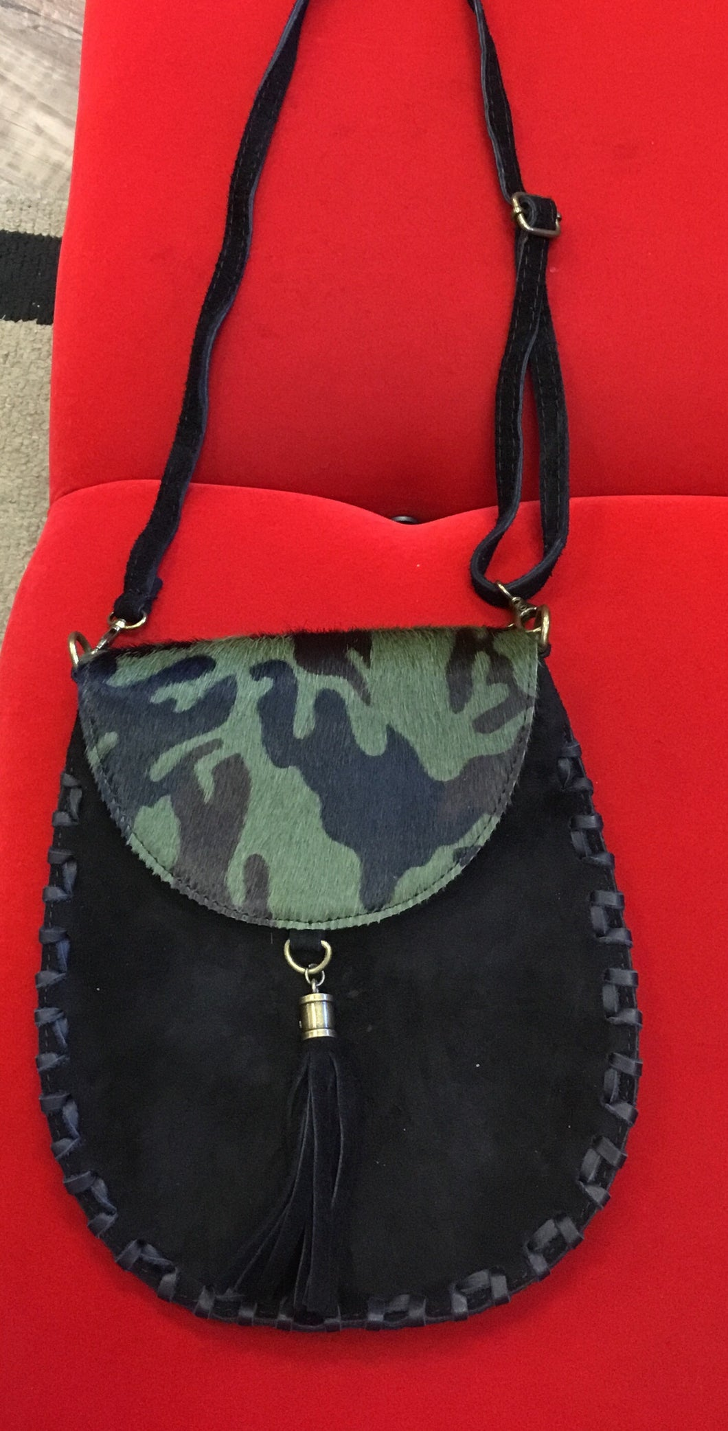 Crossbody bag in suede with camouflage flap and tassel