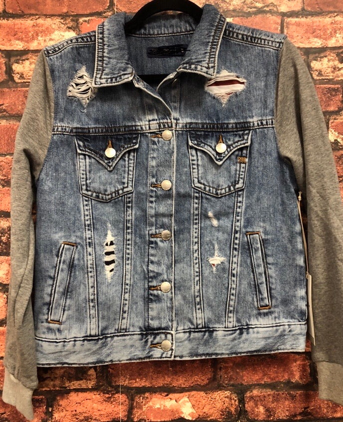 Distressed denim jacket with sweatshirt sleeve