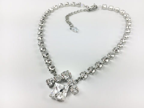 Jewelry for Real Estate Professionals. The House Necklace from Mesa Jewelry and Real estate Agent. Designer collection featuring Swarovski crystal clear crystals.