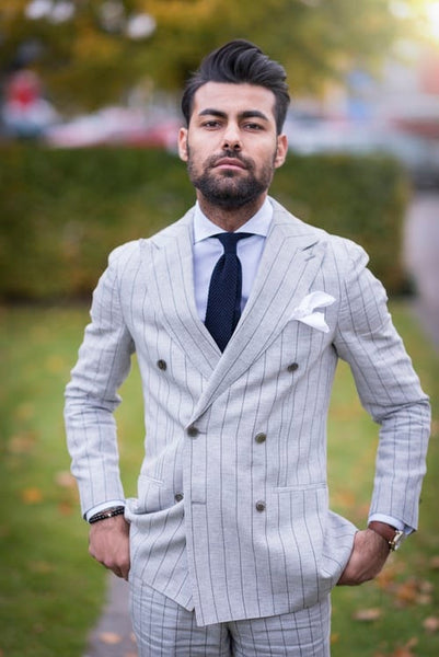 A men in a blazer with stripes