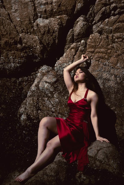 A women in a sexy red satin dress