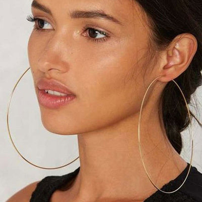 Complete any look with these Golden hoop earrings. These Golden hoops are finished with hinged closures for easy wear.  Finish: Golden-Color  Diameter: 4 inches ( 100 MM )  Material: Metal  2 Years color change grantee