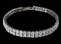 "This Silver Color 2 Row Diamond Bracelet weighs approximately 31 grams and showcases zirconia diamonds. Featuring a 2 row design and a luxurious rhodium plating for extra shine, this silver diamond bracelet is an affordable alternative to gold jewelry. The listing is for the bracelet in 7.5"", please let us know if you need the length to be shorter.   Closure: Push lock   Length: 7""-7.5''  Country of Origin: Imported  Color: I-JDiamond"