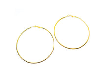 Complete any look with these Golden hoop earrings. These Golden hoops are finished with hinged closures for easy wear.  Finish: Golden-Color  Diameter: 3 inches ( 75MM )  Material: Metal  2 Years color change grantee