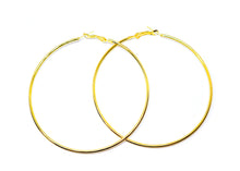 Awesome golden hoop earrings  Finish: Golden-Color  Diameter: 2 inches ( 50 MM )  Material: Metal  2 Years color change grantee
