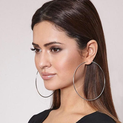 Complete any look with these silver color hoop earrings. These silver hoops are finished with hinged closures for easy wear.  Finish: Silver-Color  Diameter: 3 inches ( 75MM )  Material: Metal  2 Years color change grantee