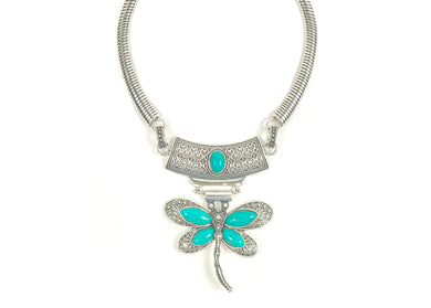 A dragonfly, a focal pointed is presented for your enjoyment.  A lovely blue color tear shape turquoise drop adds another layer of joy to this necklace.  Dragon Fly Metal necklace with blue stone  Blue stone  Dragon fly design  claw clasp  Metal necklace