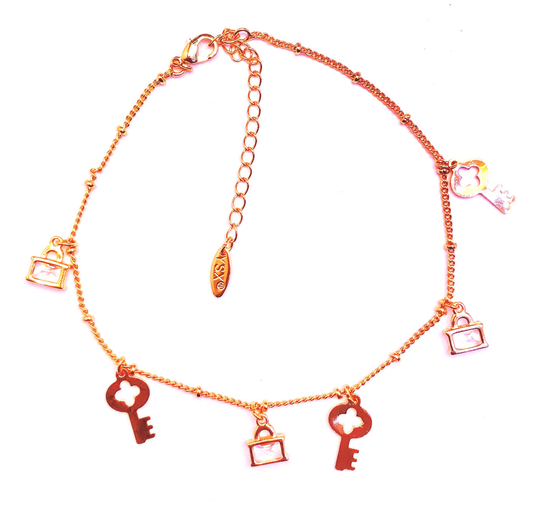 golden keys and stud anklet