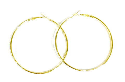 These little hoops add beautiful shine to style. The gold hoops have a rounded finish.  Gold-tone finish Ole