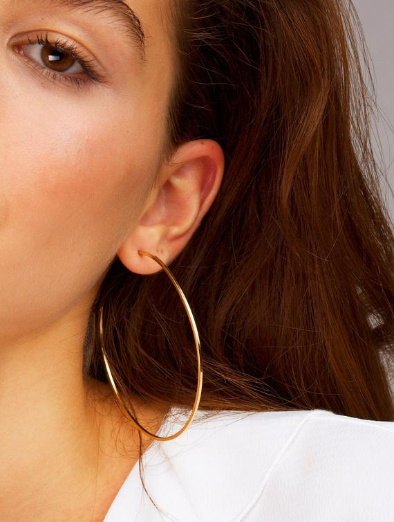 Awesome Rose golden hoop earrings  Finish: Rose Golden-Color  Diameter: 3 inches ( 70 MM )  Material: Metal  2 Years color change grantee