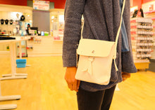 Beige cross body bag.
