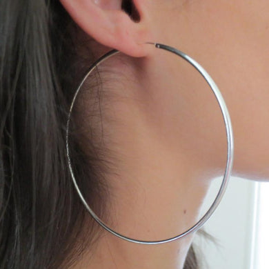 Awesome Silver-Color hoop earrings  Finish: Silver-Color  Diameter: 2 inches ( 50 MM )  Material: Metal  2 Years color change grantee