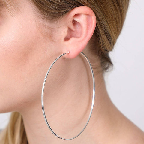 Complete any look with these silver color hoop earrings. These silver hoops are finished with hinged closures for easy wear.  Finish: Silver-Color  Diameter: 4 inches ( 100MM )  Material: Metal  2 Years color change grantee