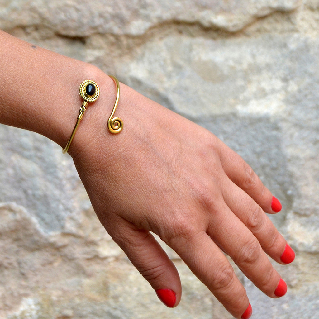 Tribal gold bangle