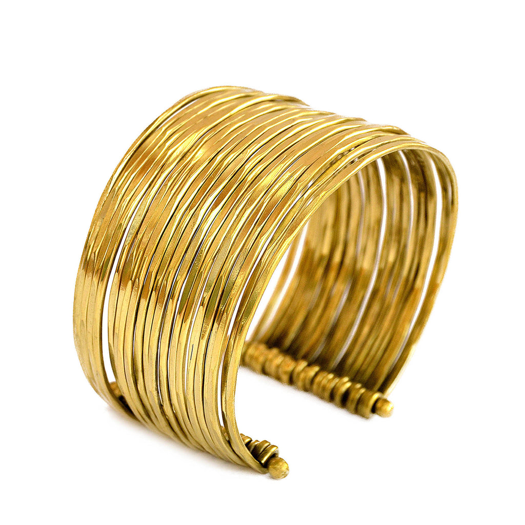Boho gold cuff bracelet with multiple attached bangles
