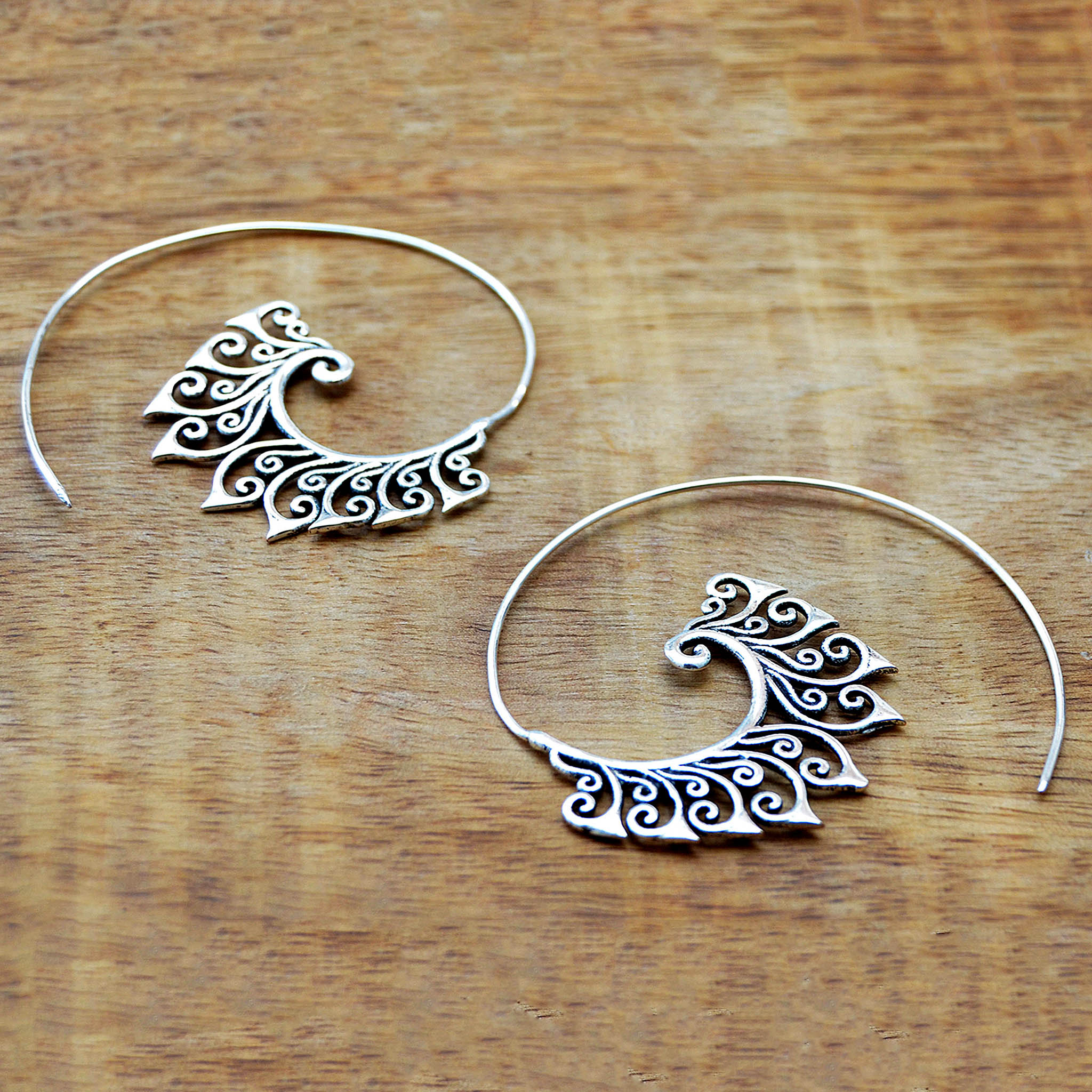 Ethnic silver floral spiral hook earrings