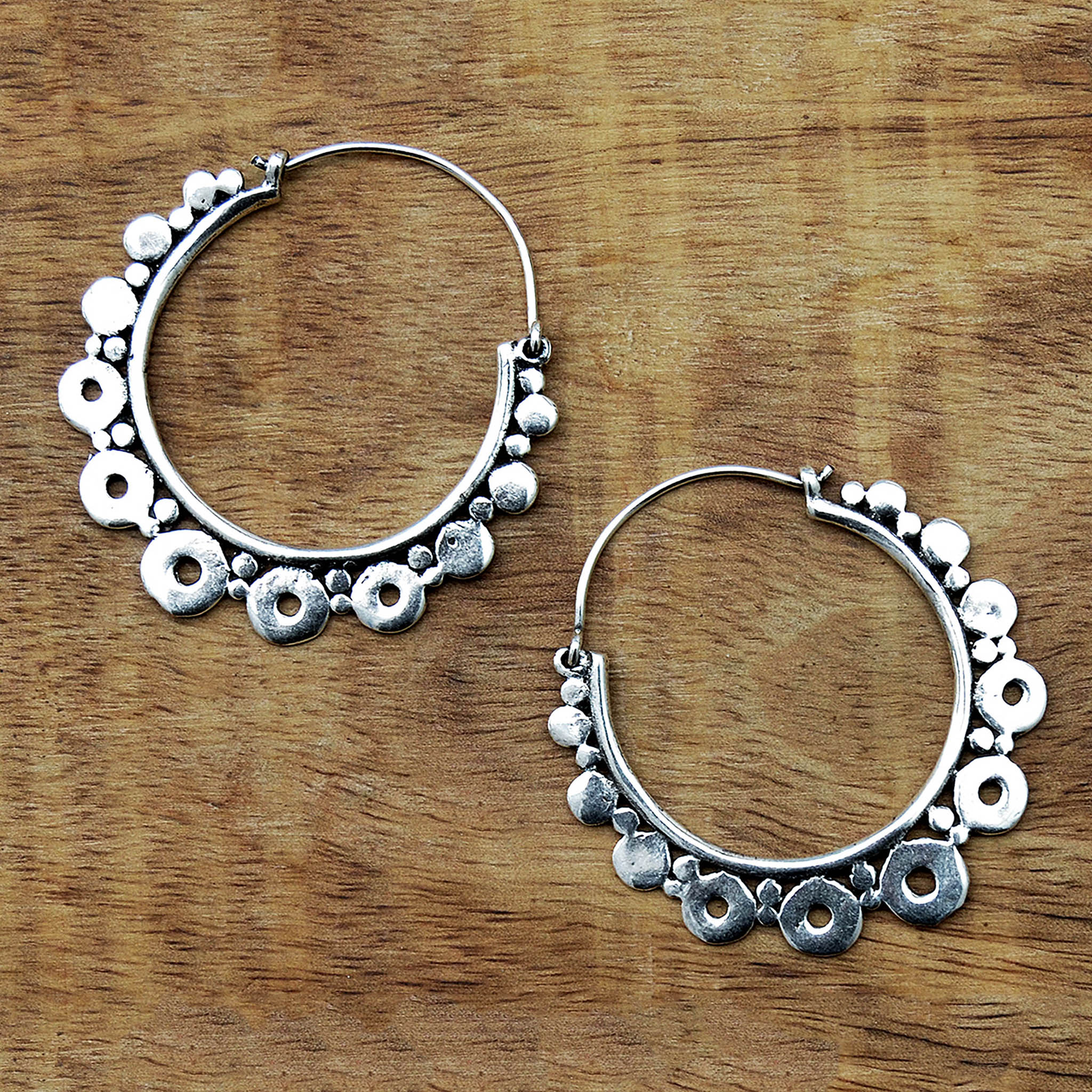 Silver yoga hoop earrings