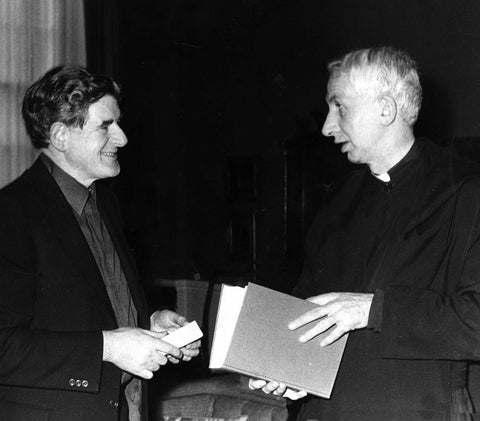 Austin presenting a specially bound copy of the Vatican II docs to Cardinal Basil Hume Archbishop of Westminister