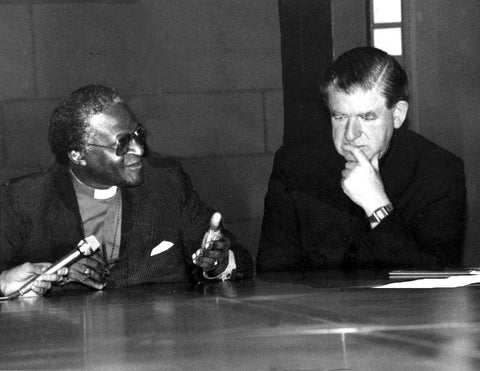 Austin with Archbishop Desmond Tutu, of Capetown, and marks his involvement in the anti-apartheid movement
