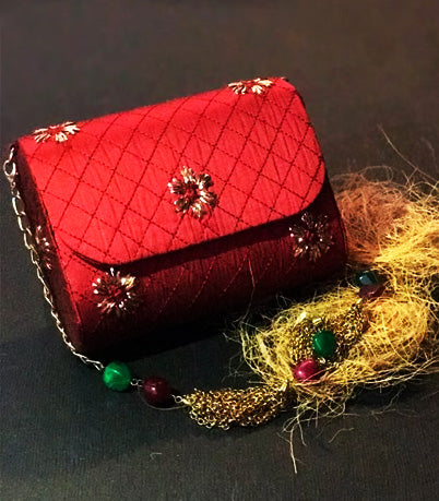 Clutches, accessories, party wear, silk, satin, cotton, brocade, net, lace, potlis, embroidered, tie dyed, embossed, cut work.