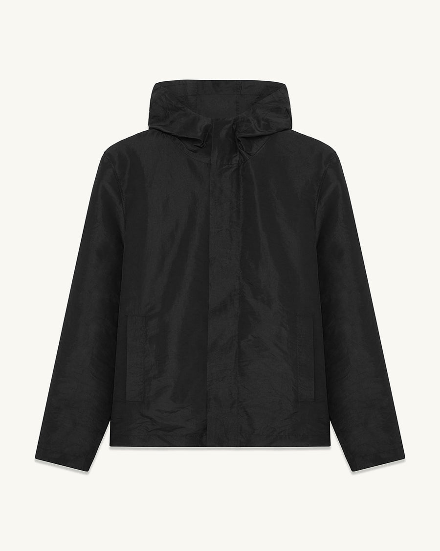Camden hooded jacket with envelope pocket.  ###  - Cured polyester fabric - Double faced - Black finish snaps  - Small zip at the front of garment  - Waxed string adjuster  - Cropped style  - 100% Polyester  - Made in England