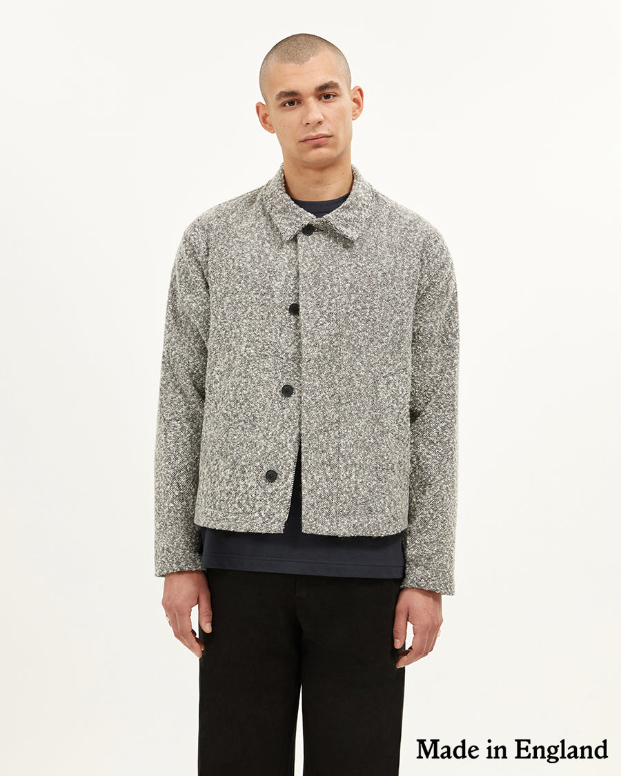 Bexley collared jacket in melange.  ###  - Wool Mix bounce fabric - Zip and button closure - Bias binding internal finish - Cropped style - Wide sleeve fit  - 30% wool 67% Polyester  - Made in England