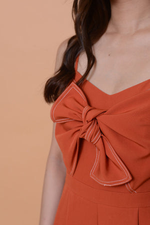 Collections-Ribbon tier jumpsuit in orange