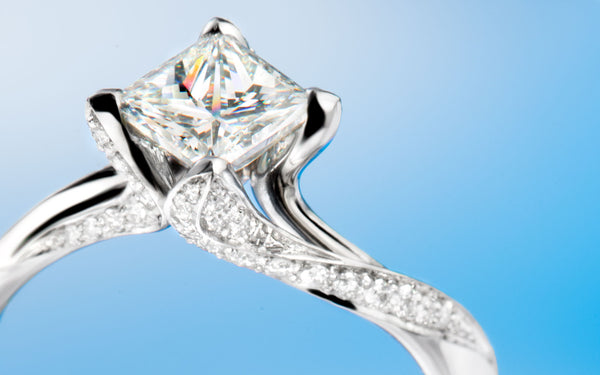 "Princess diamond and small briliant cut diamonds, in ""Countess"" engagement ring"