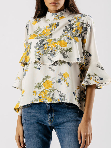 Floral ruffle cream top