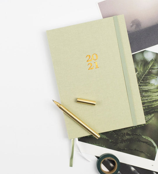 Ponderlily 2021 Planner in sage green with stationery items and images