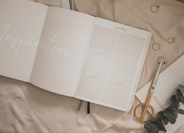 Ponderlily Undated Weekly Planner open at our signature Wanderlist page for planning goals for an inspiring life